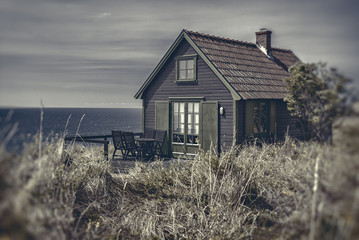 Seaside cottage at dusk