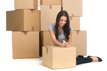 mid adult happy woman during move with boxes at new flat.