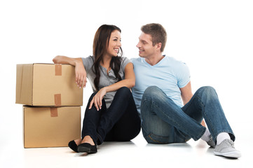 Young smiling couple moving in new house.
