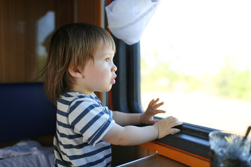 lovely toddler out of window in the train