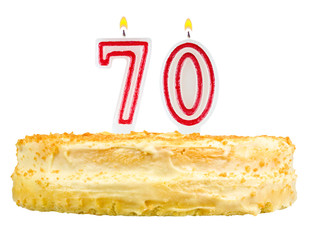 birthday cake with candles number seventy isolated on white