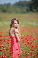 Beautiful Girl in the poppy field, red dress