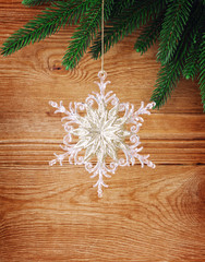 snowflakes and fir tree on wood background