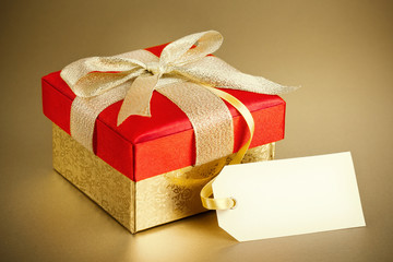 Christmas gift box on gold background