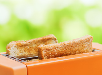 Orange toaster with two slices of bread