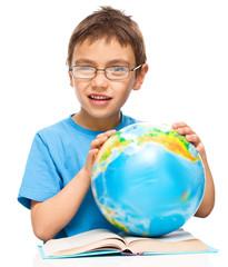 Little boy is holding globe
