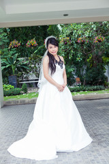 Beauty young bride in white dress