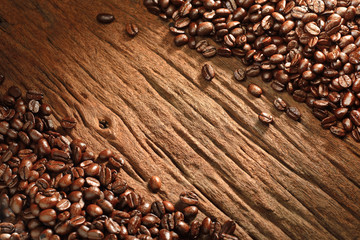 Top view of coffee beans on old wooden background