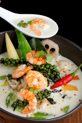 Traditional thai green curry with shrimps