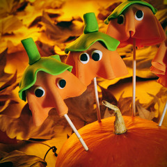 homemade cake pops with the shape of ghost Halloween pumpkins, w