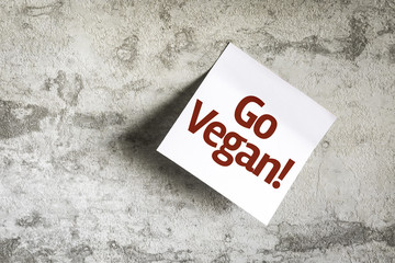 Go Vegan on Paper Note on texture background