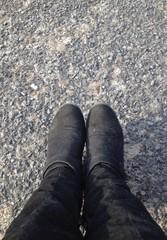 black boots on pavement