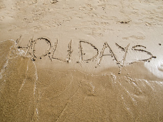 escrito vacaciones en playa