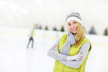 Cheerful woman on a skating rink