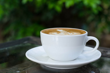 white cup of hot coffee outdoor