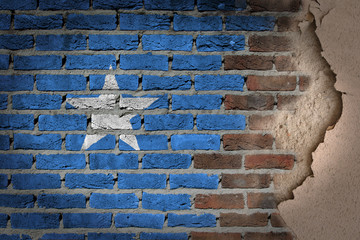 Dark brick wall with plaster - Somalia
