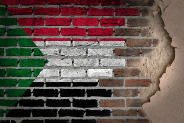 Dark brick wall with plaster - Sudan