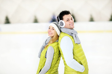 Romantic couple on the skating rink
