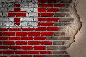Dark brick wall with plaster - Tonga