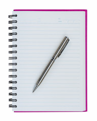 Silver ball point pen on pink notebook