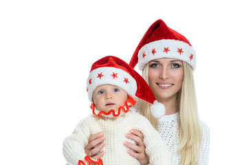 Cute mom and baby in santa hats