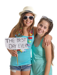 Two friends holding a Best Day Ever sign