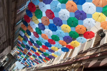 Street decorated with colored umbrellas oblique view