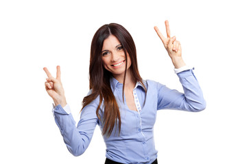 Smiling businesswoman showing victory sign