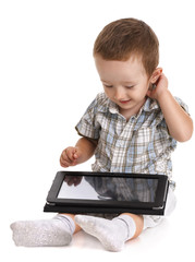 Baby toddler looking bemused at a digital tablet