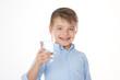 Leinwandbild Motiv smiling boy with water