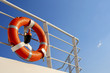 Leinwanddruck Bild - Life buoy on the deck of cruise ship