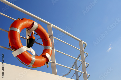 Leinwanddruck Bild Life buoy on the deck of cruise ship