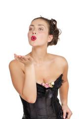 Beautiful girl sends an air kiss, blows on a palm
