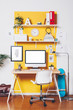 Modern creative workspace on yellow wall. - 70904878