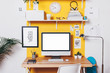 Modern creative workspace on yellow wall. - 70904889