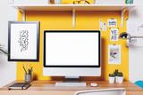 Fototapety Modern creative workspace on yellow wall.