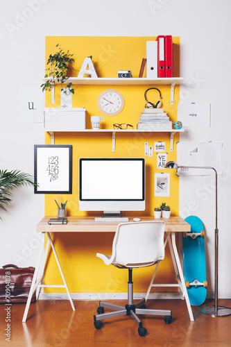 Modern creative workspace on yellow wall. - 70904878