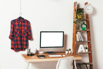 Minimal office on white background.