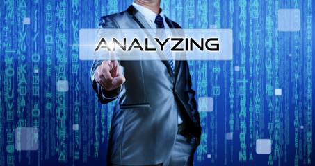 Business man with digital background pressing on button analyzin