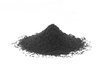 Handful of granular carbon powder on white background