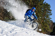 Rider cycling on mountain bicycle in the snow winter forest - 70908448