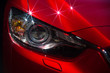 Hood and headlights of sport red car with silver stars - 70908451
