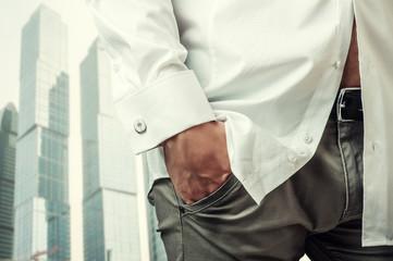 Man's hand in white shirt with cufflink