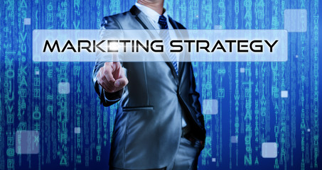 Business man with digital background pressing on button marketin