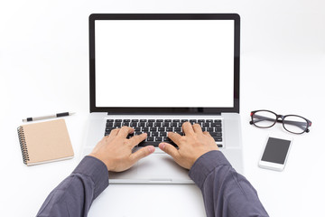 Man hand typing on laptop keyboard with blank screen monitor