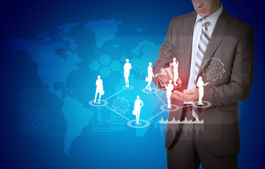 Businessman and world map with businesswoman silhouettes