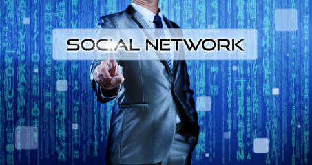Businessman pressing on button social network