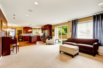 Spacious living room with kitchen area.
