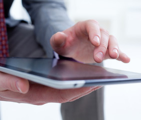 Male hands touching digital tablet