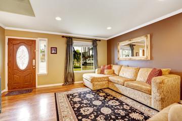 Living room with comfortable creamy tone sofa